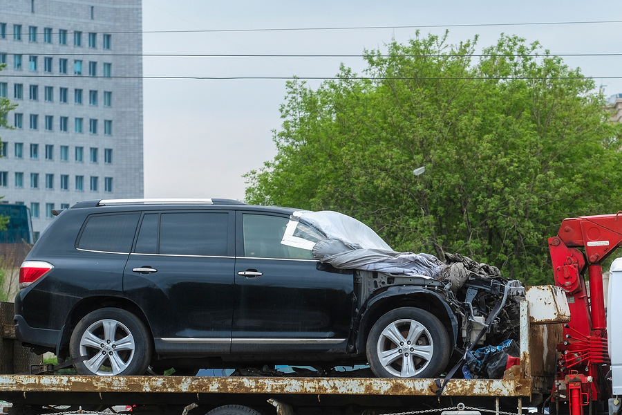 Moscow, Russia - May, 6, 2018: the image of the tow truck carrying the broken car